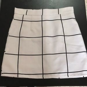 White skirt with black stripes. Zipper in back